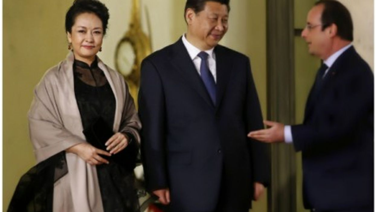 Peng Liyuan and her husband Chinese President Xi Jinping, with French President Francois Hollande