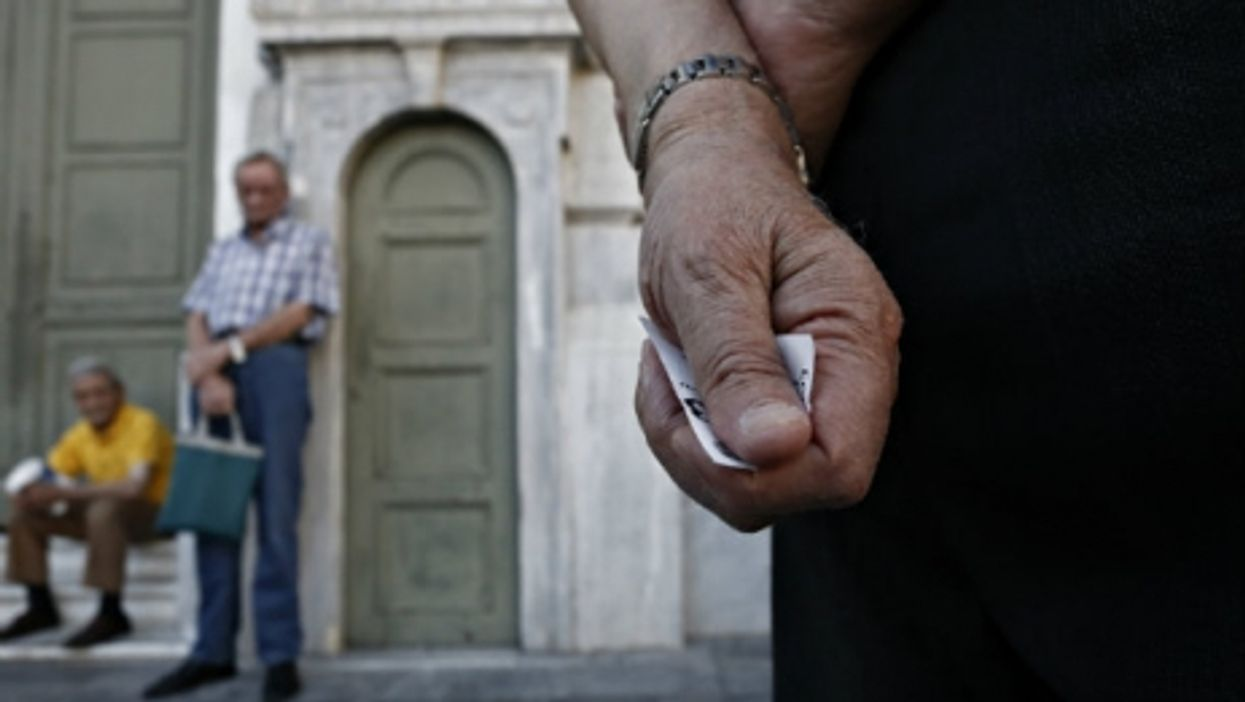 Pensioners line up outside the main gate of the national bank of Greece this week to withdraw a maximum of 120 euros .