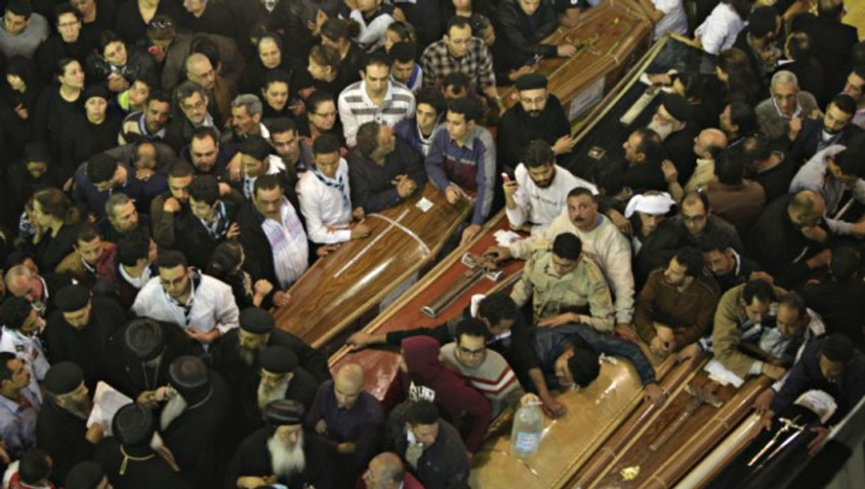 People attend the funeral of victims of the blast in Alexandria, Egypt on Sunday.