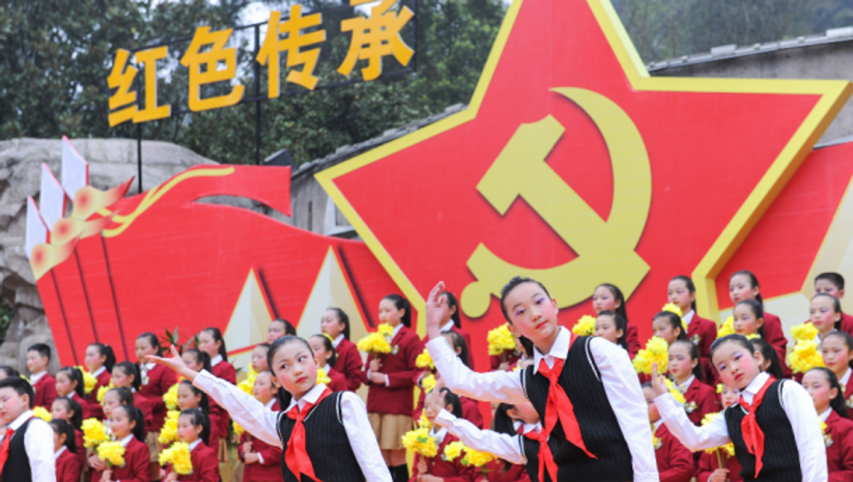 People attending a festival to cherish the martyrs at the red army martyrs cemetery in Zunyi, Guizhou,China