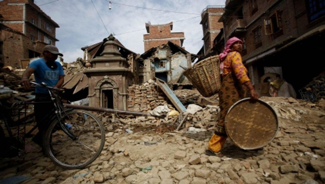 People carrying their belongings in Lalitpur, near Kathmandu, on May 16