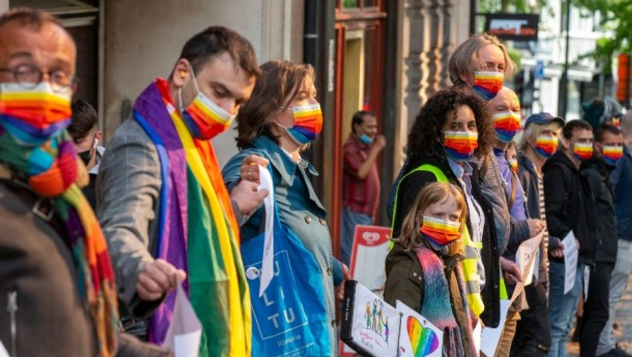 People form a human chain to raise awareness for discrimination against LGBTQI+ in Brussels, Belgium, on the International Day Against Homophobia, Transphobia and Biphobia —