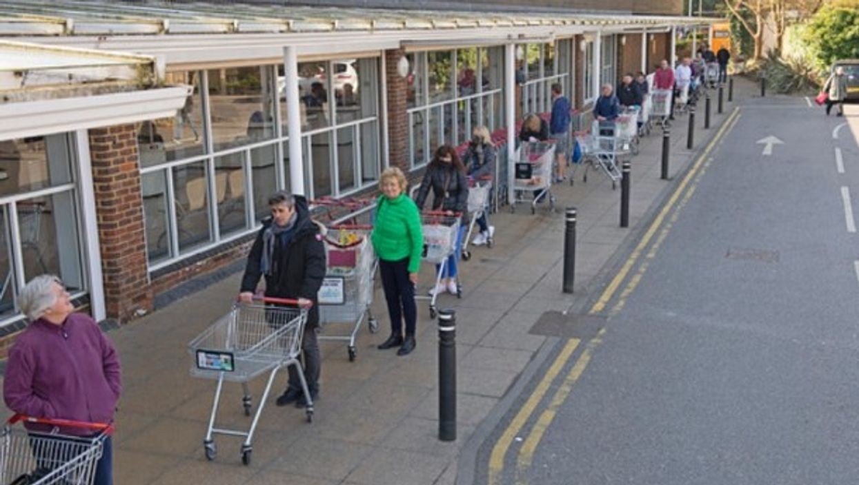 People lining up at a grocery store in South East London