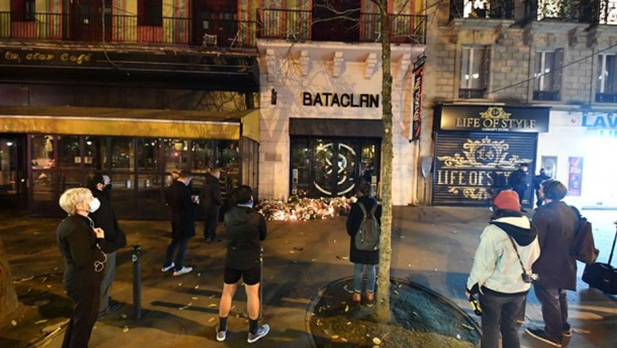 People paying tribute to victims in front of the Bataclan, Paris.