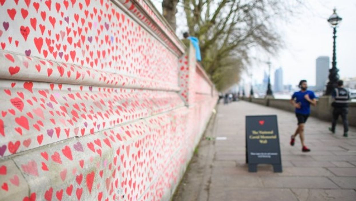 People walk past the COVID-19 Memorial Wall in London, in March 2021.