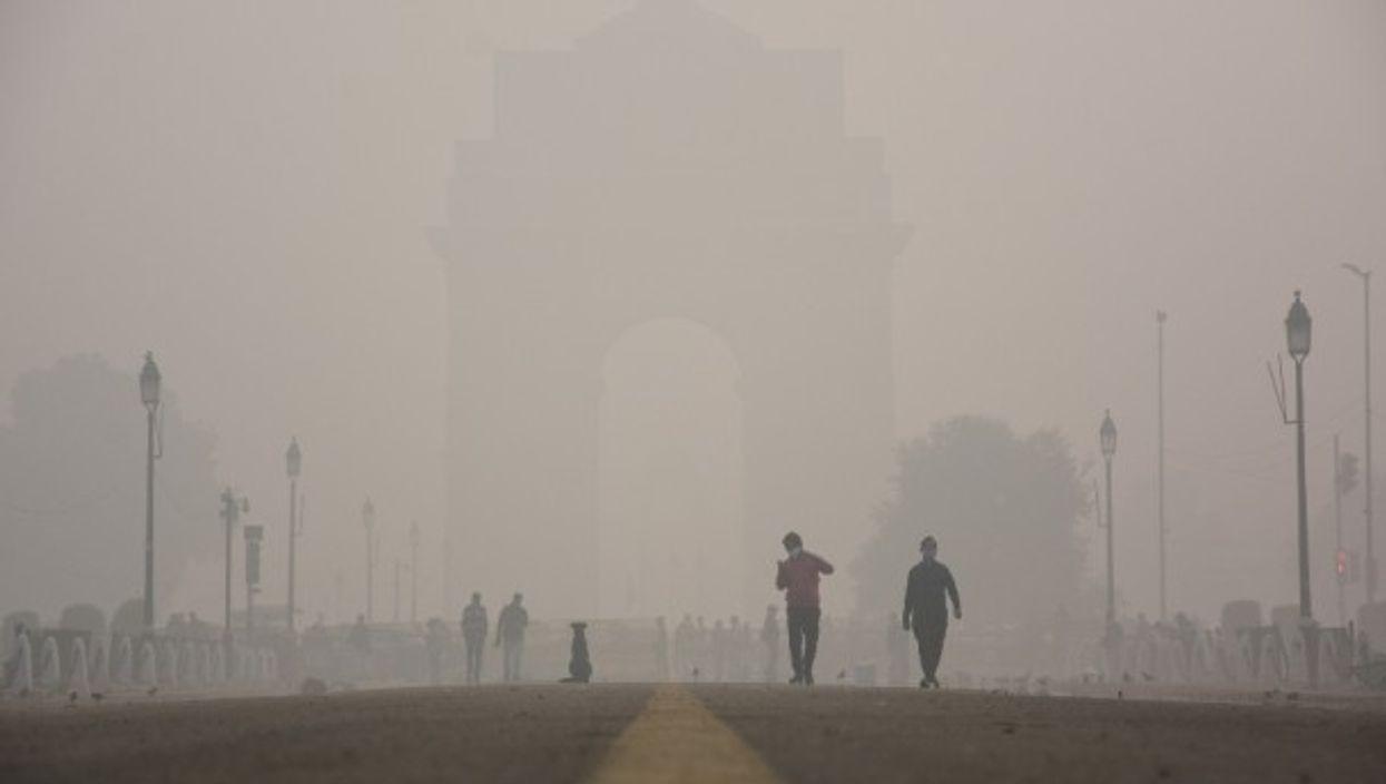 People walking amid heavy smog in New Delhi