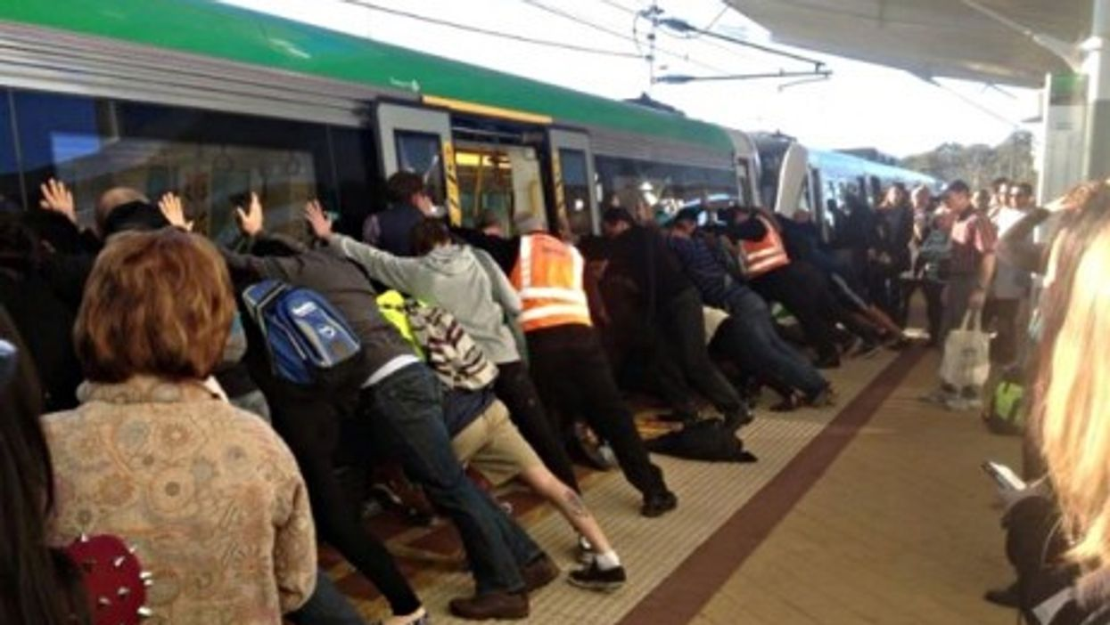 Perth commuters team up to free a trapped passenger