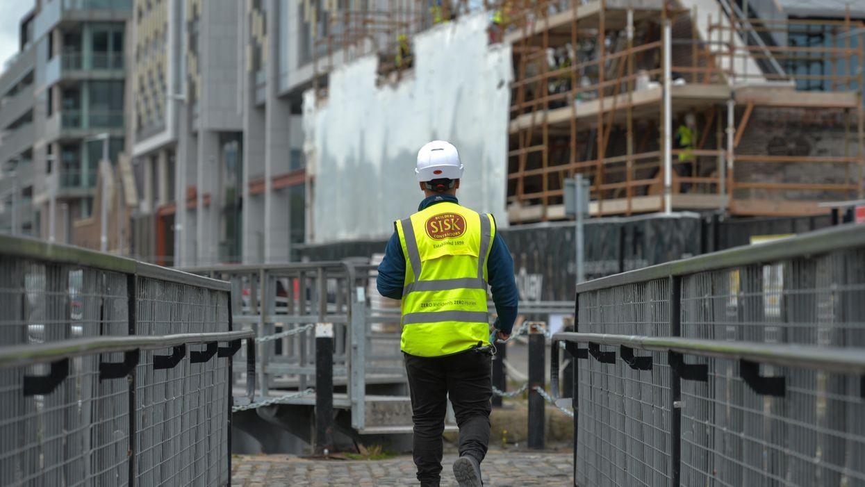 photo of a construction worker in Dublin walking away