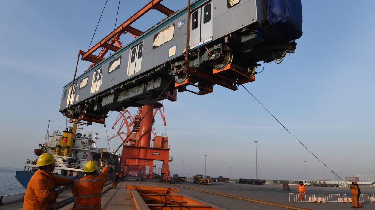 Photo of a train car lifted by a crane