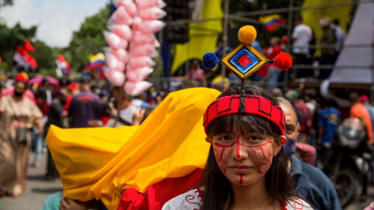 Photo of a woman participating in a march during the Day of Indigenous Resistance in Caracas, Venezuela, on October 12