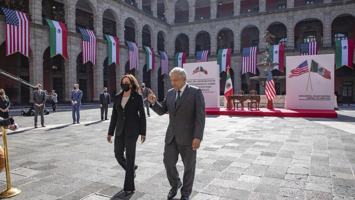 Photo of U.S. Vice President Kamala Harris and Mexican President AMLO walking in the couryyard of the National Palace during in Mexico City on June 8