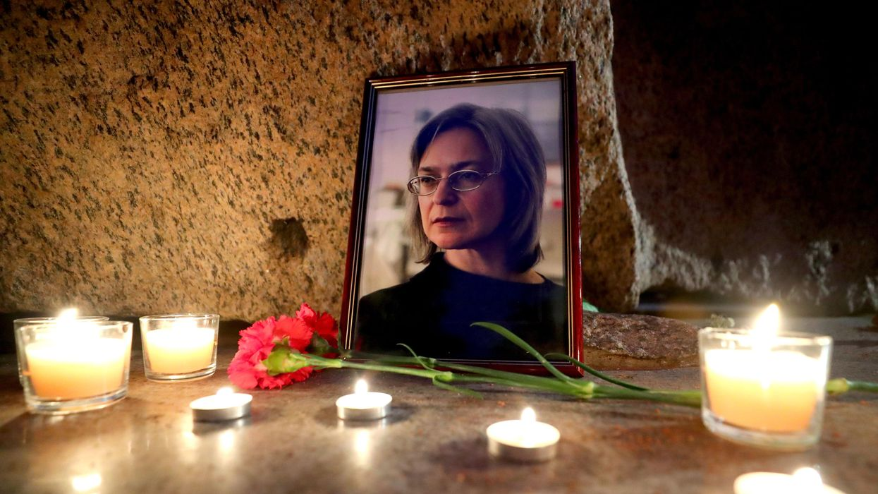 photos of a candlelit memorial for slain Russian journalist  Anna Politkovskay