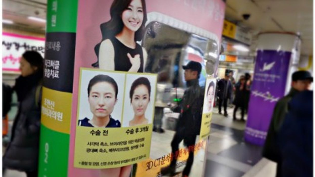 Plastic surgery ads in Seoul's Apgujeong subway station
