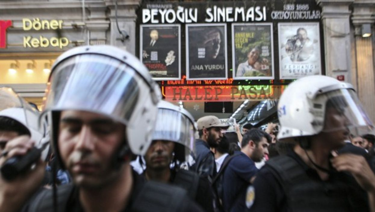 Police and protestors gather at Gezi park