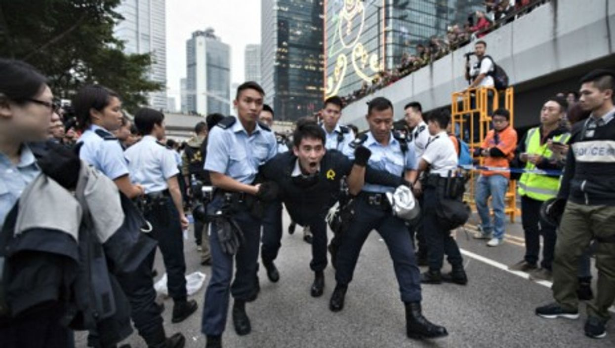 Police dismantling the Occupy Central HQ in Hong Kong on Dec. 11