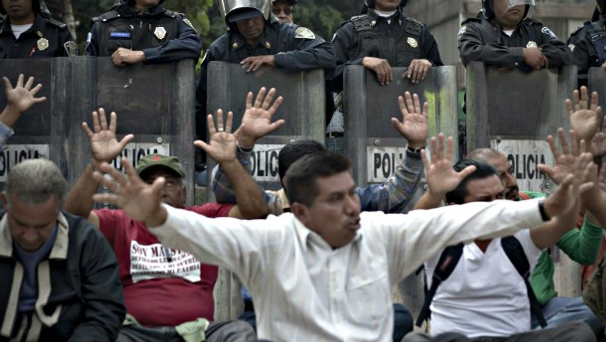 Police forces and teachers protesting in Mexico City