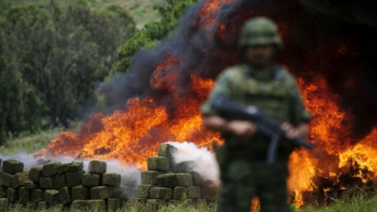 Police forces burning drugs in La Venta del Astillero, Mexico