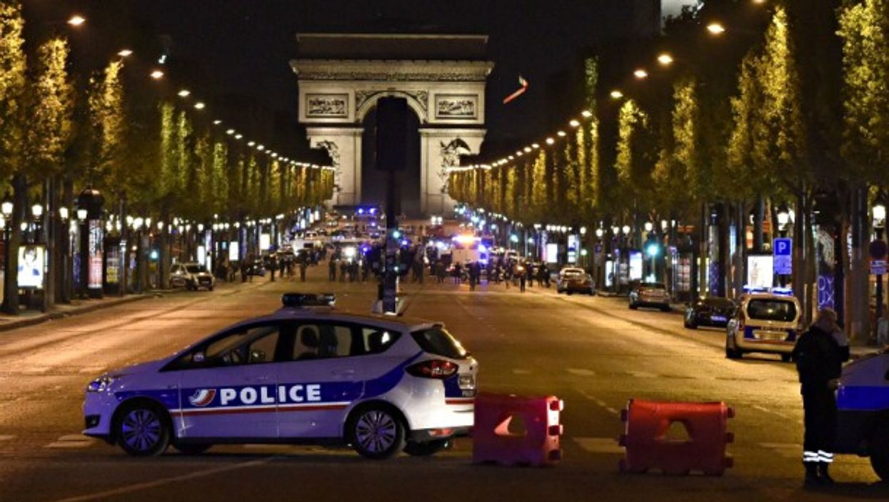 Police forces on Paris' Champs Elysees on April 20