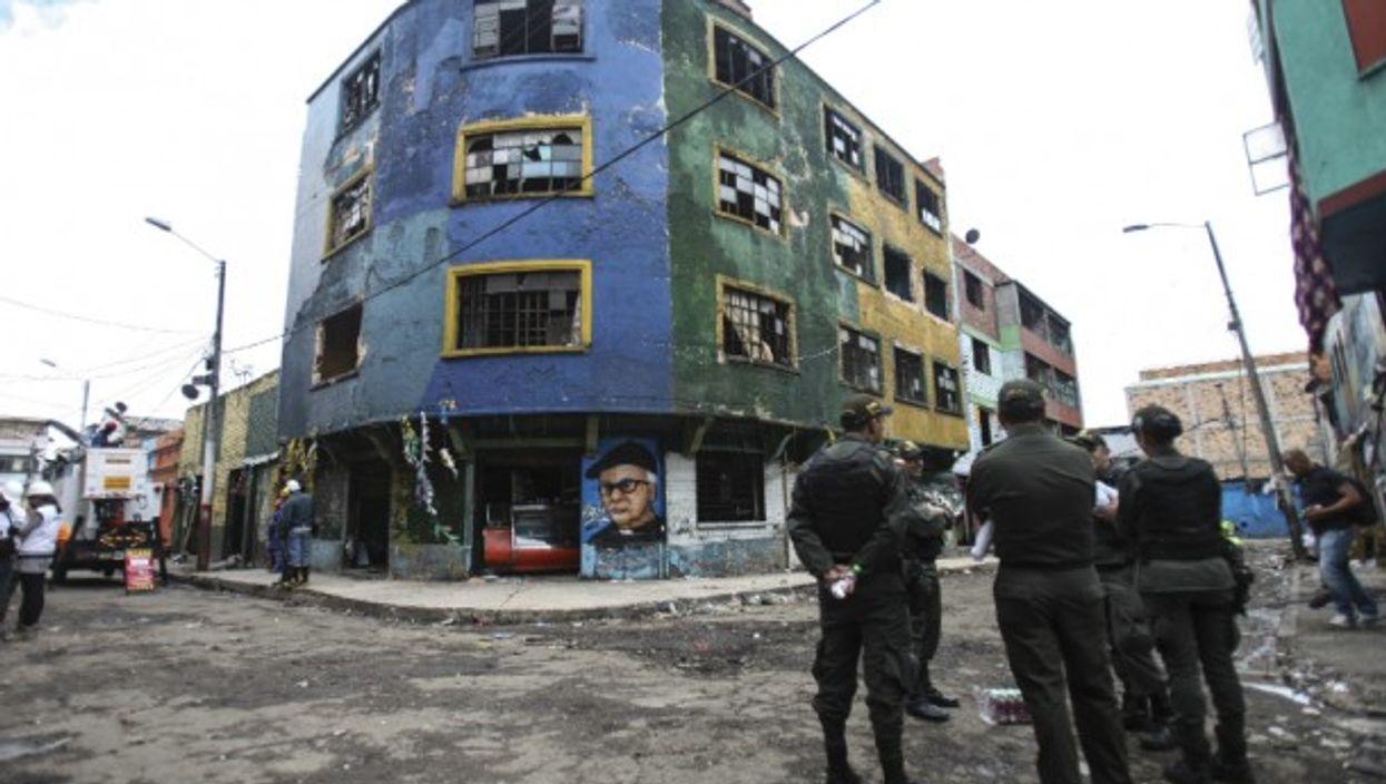 Police guard a street in Bogota.