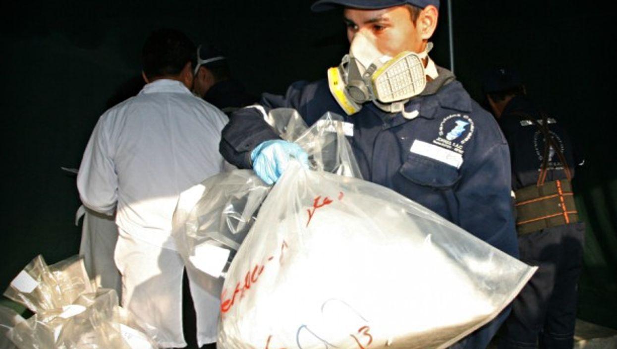 Police officer seizing drugs in Ate Vitarte, Peru