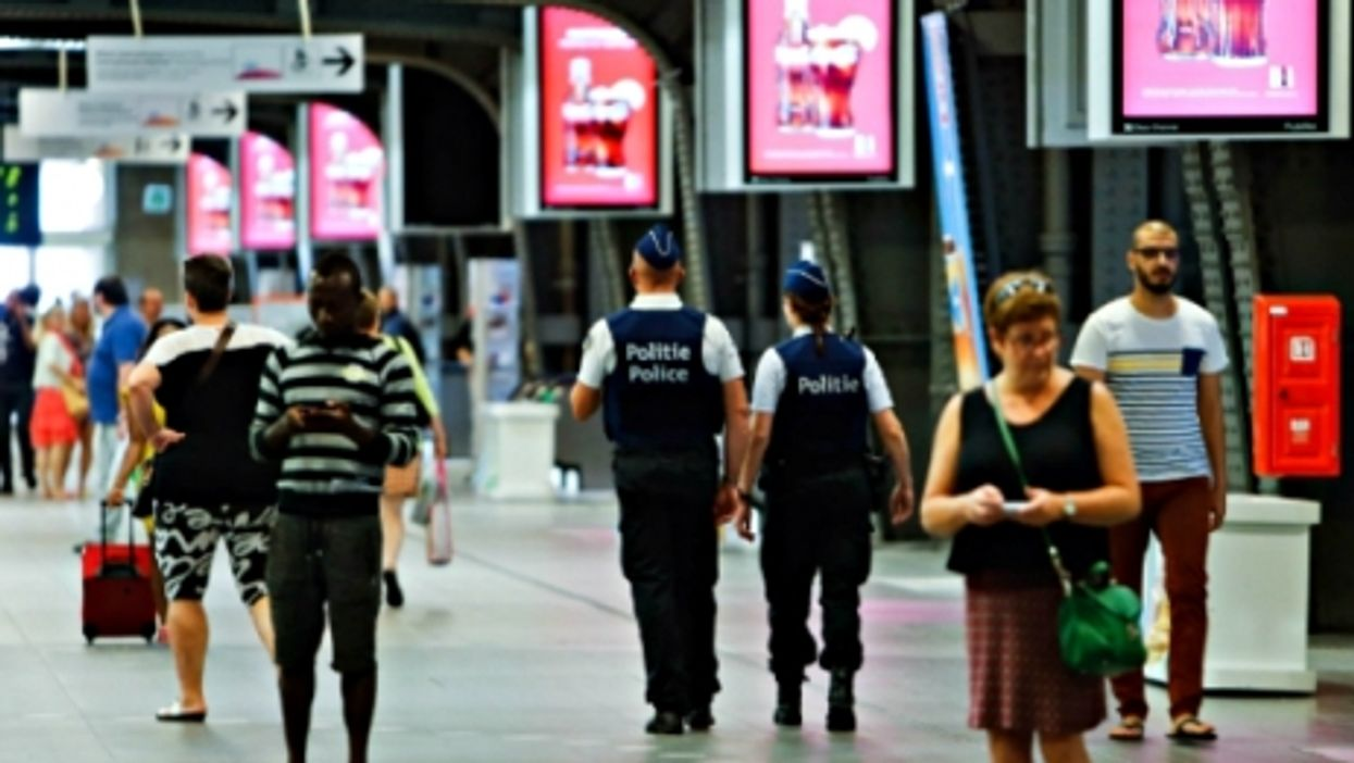 Police officers patrol the Brussels Midi station in the capital of Belgium on Aug. 23, 2015.
