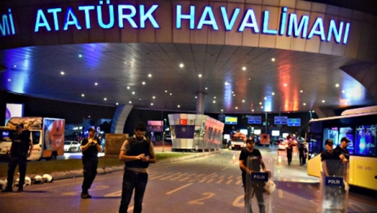 Police officers Tuesday night at the entrance to Istanbul's main airport.