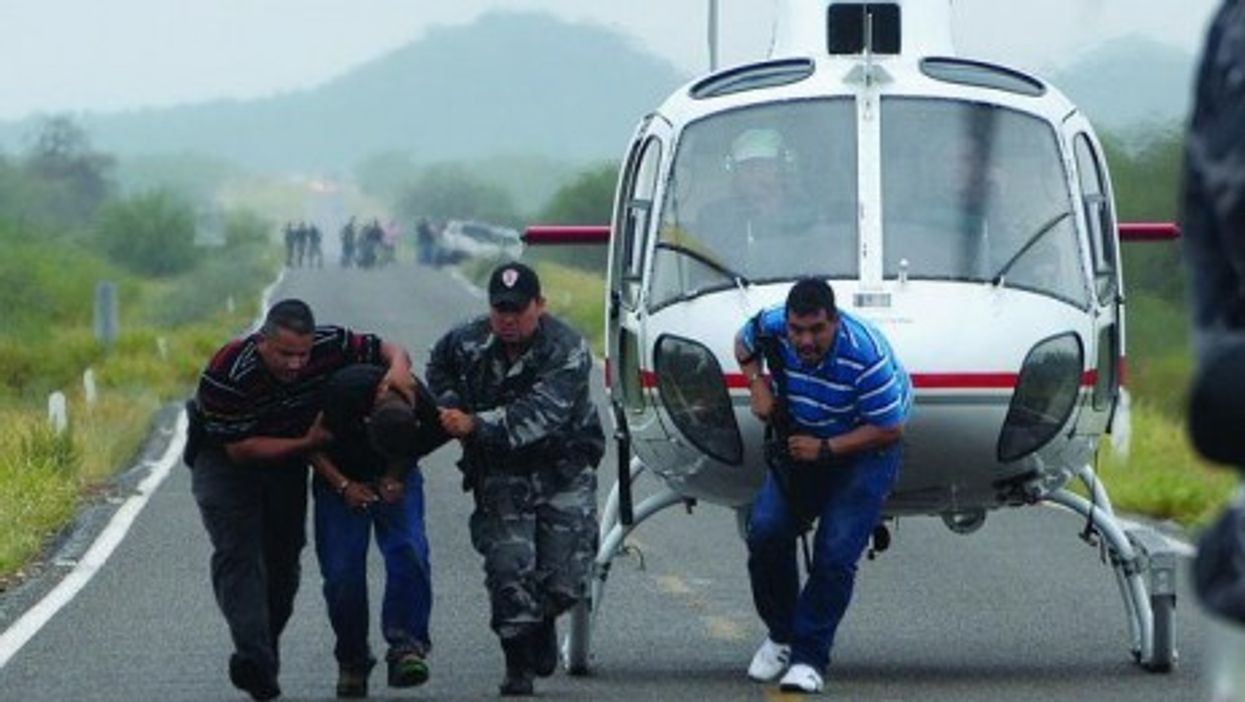 Police take a suspected drug trafficker off a helicopter in Hermosillo in the state of Sonora, in 2009 (Knight Foundation)