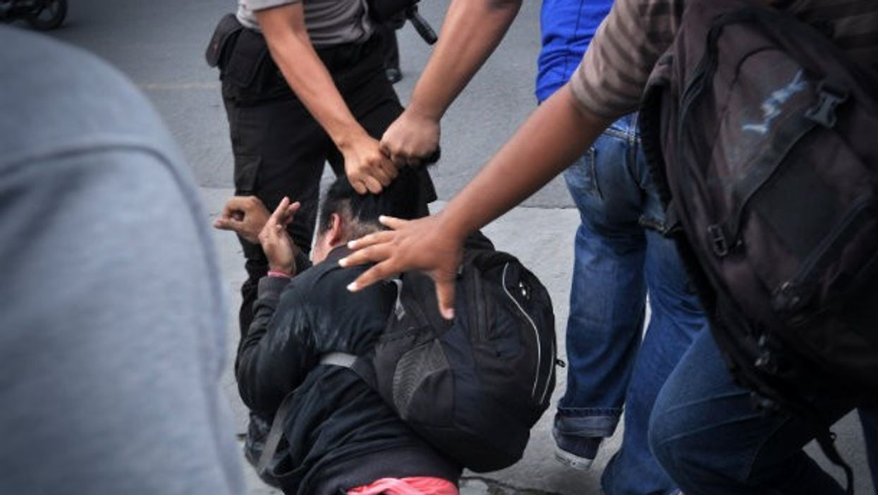 Police take down a demonstrator at a gay rights rally in Yogyakarta in February