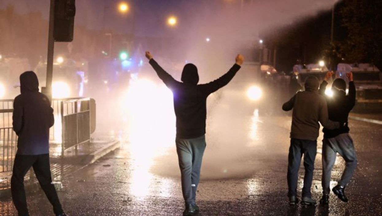 Police using water cannons on protesters in Belfast