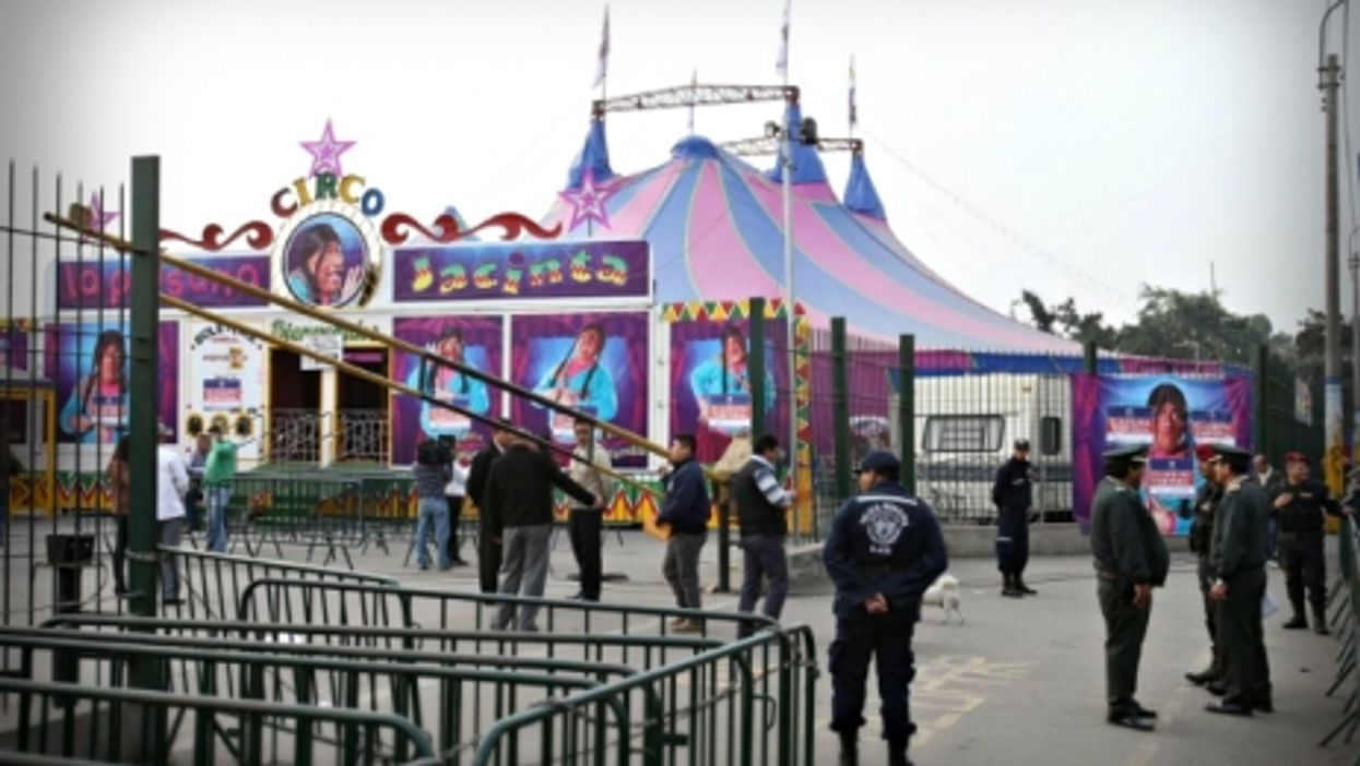 Policemen at work after the July 22 explosion in a Lima circus