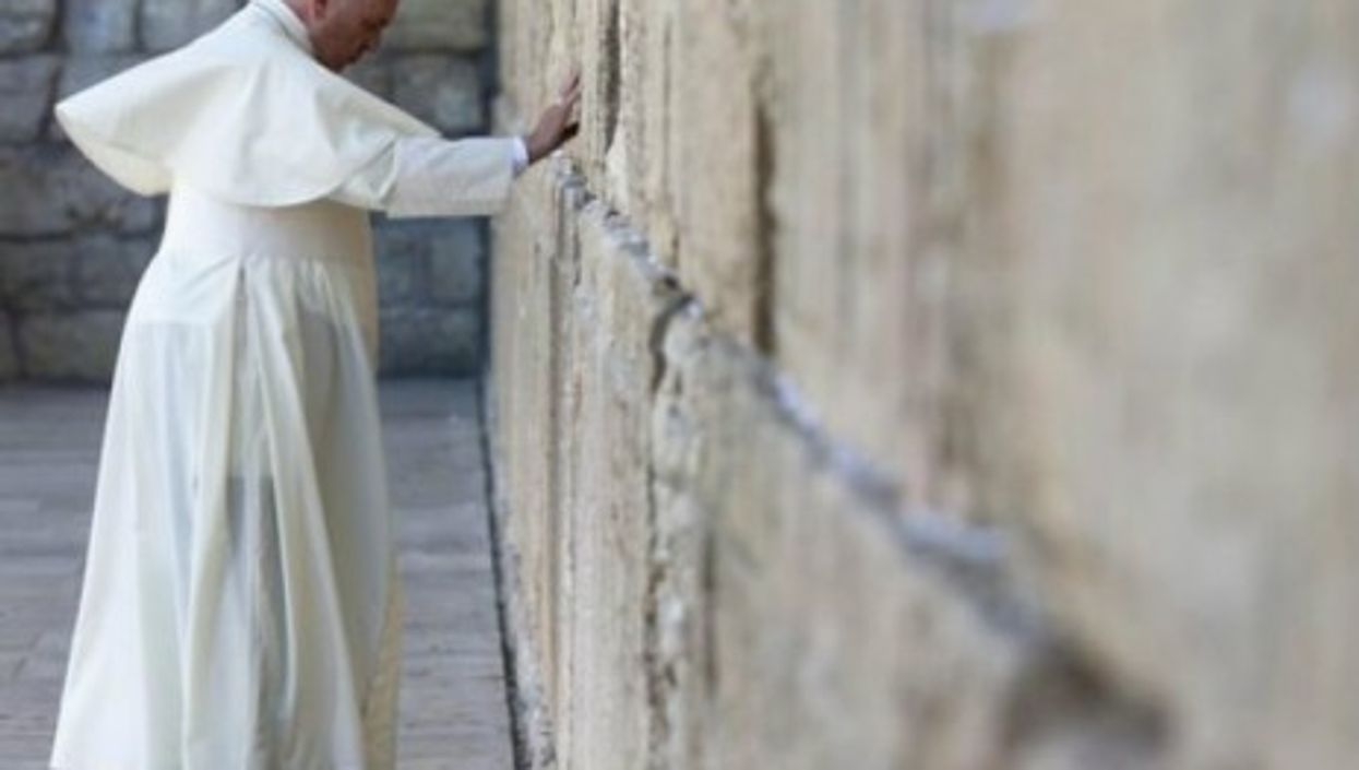 Pope Francis praying Monday at the Western Wall.