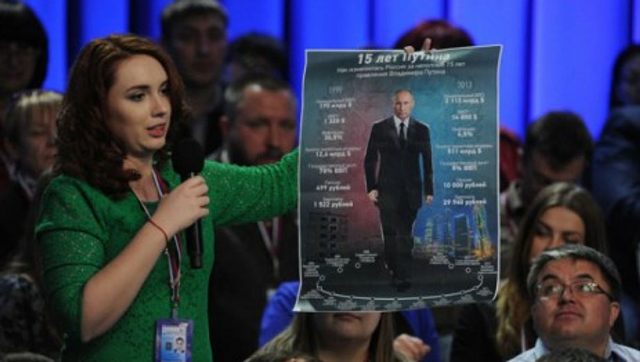 Poster boy, at the first Media Forum of Independent Regional and Local Media in St Petersburg, on April 2014.
