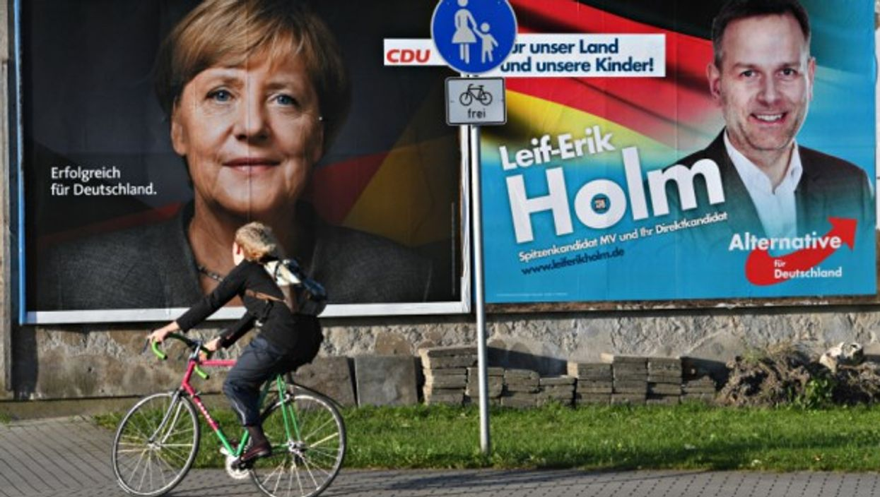 Poster for Merkel next to one for AfD in Stralsund, Germany