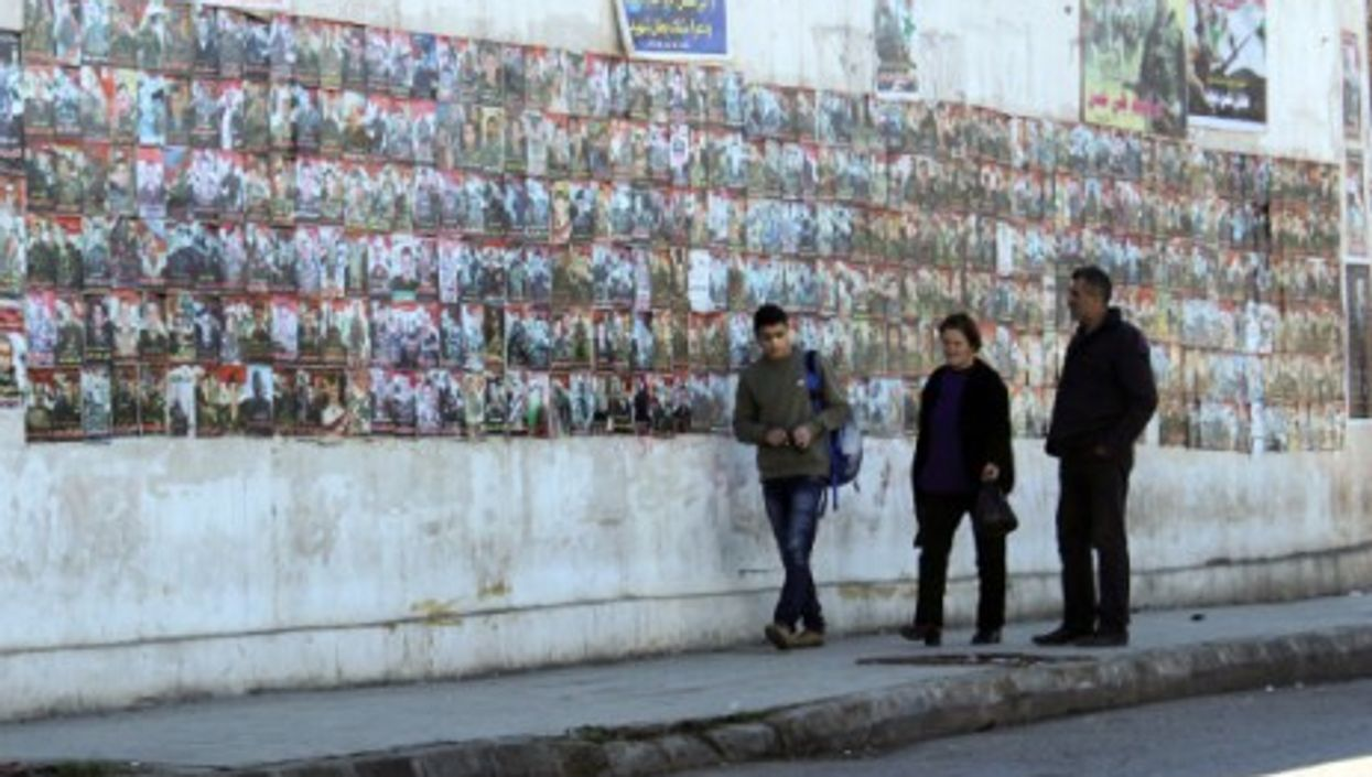 Posters of the missing or dead loved ones are hung around the city's walls