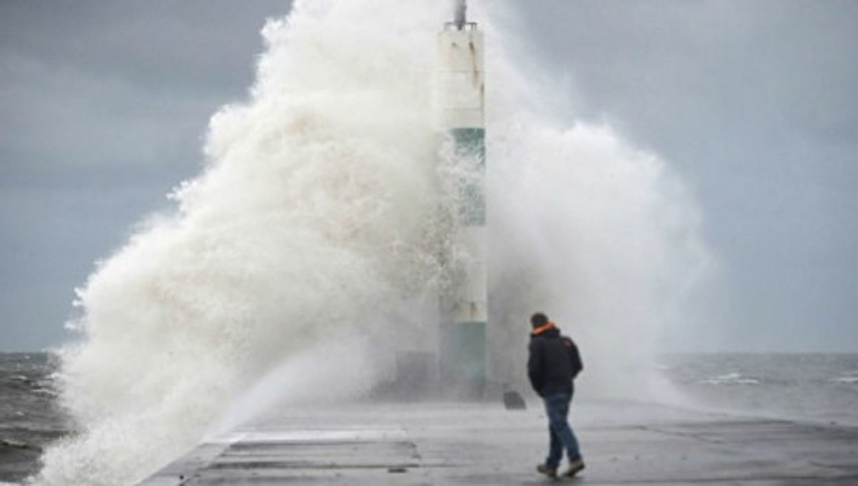 Powerful gales and giant waves battered the coast of Wales for a second day Thursday.