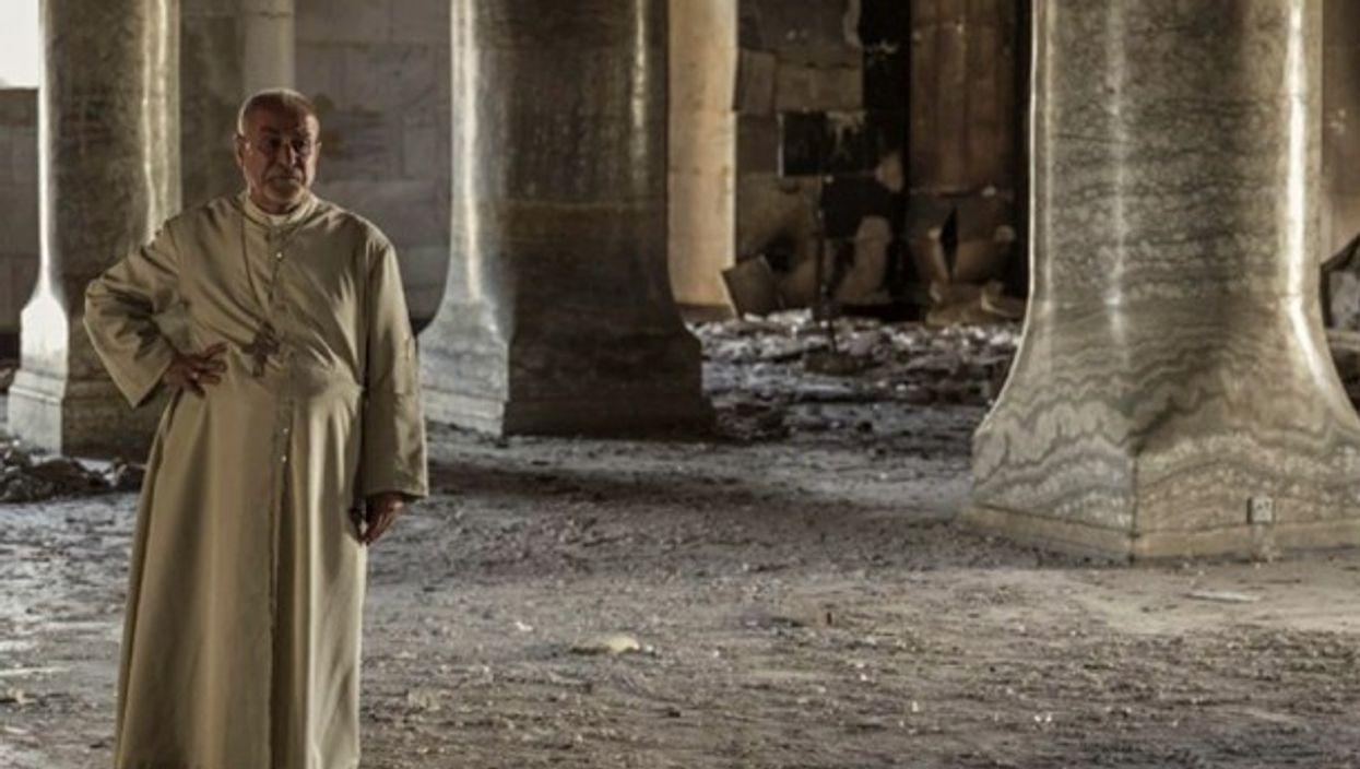 Priest of the ruined Immaculate Church in Al Hamdaniyah