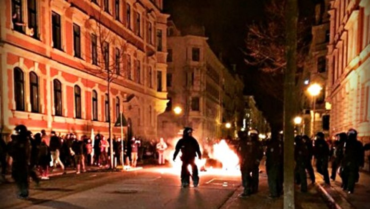 Pro- and anti-Pegida protesters clashed Monday night in Leipzig