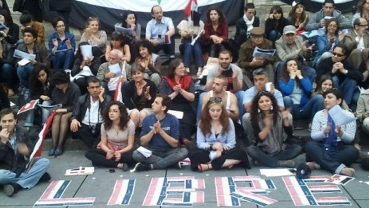 Pro-democracy Syrian demonstrators in central Paris
