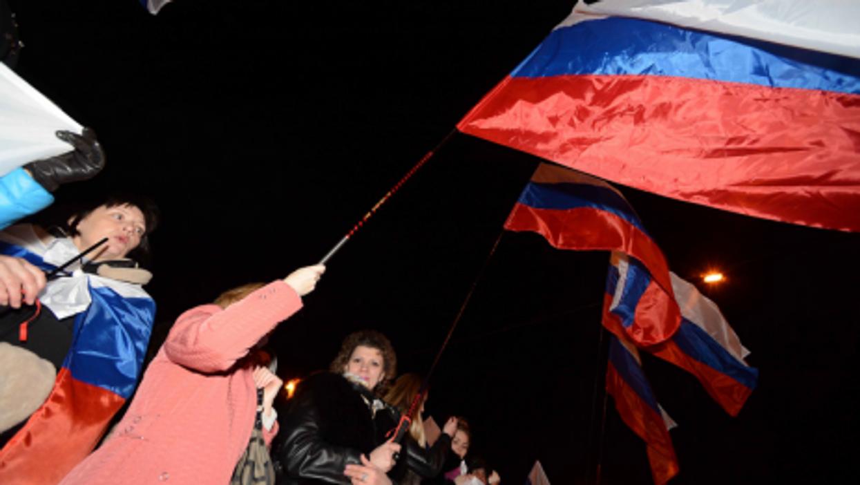 Pro-Russia supporters celebrate the referendum Sunday