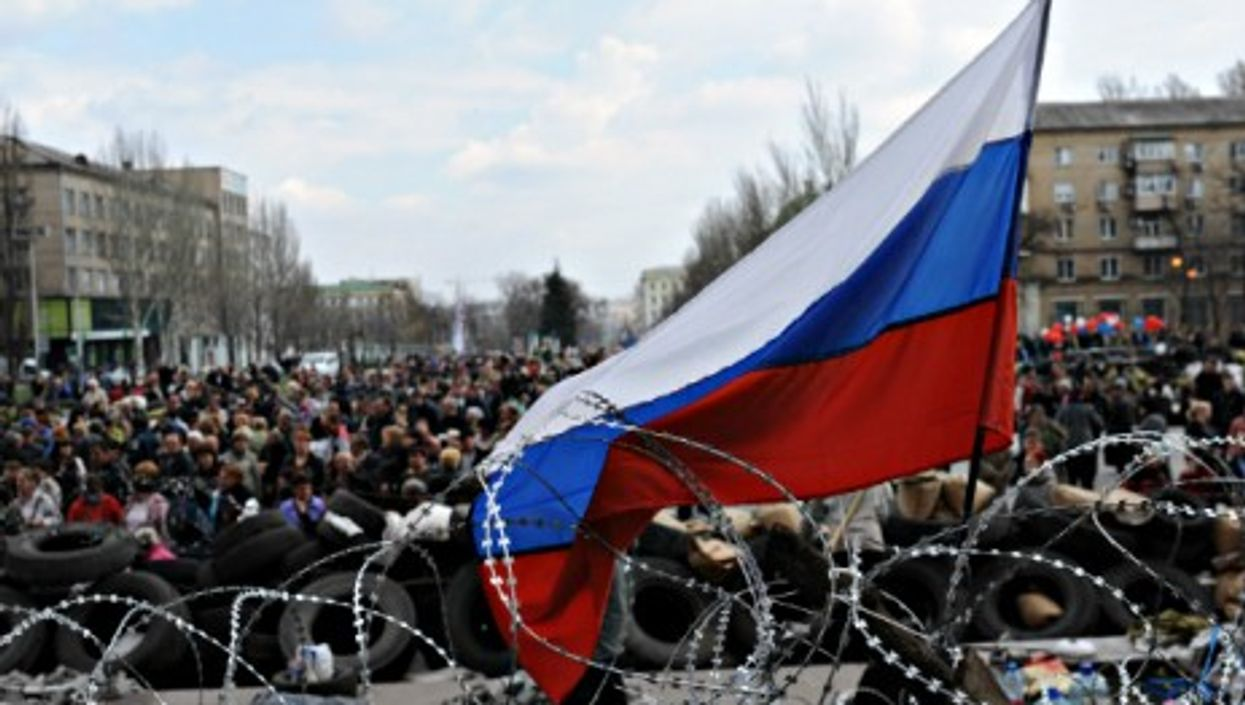 Pro-Russian activists gather in front of a government building in Donetsk on April 9.