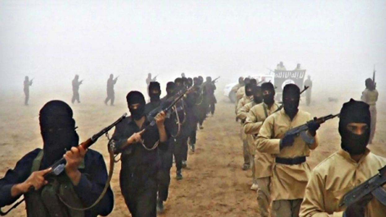 Propaganda photo released by militants showing ISIS fighters in Syria on Aug. 25