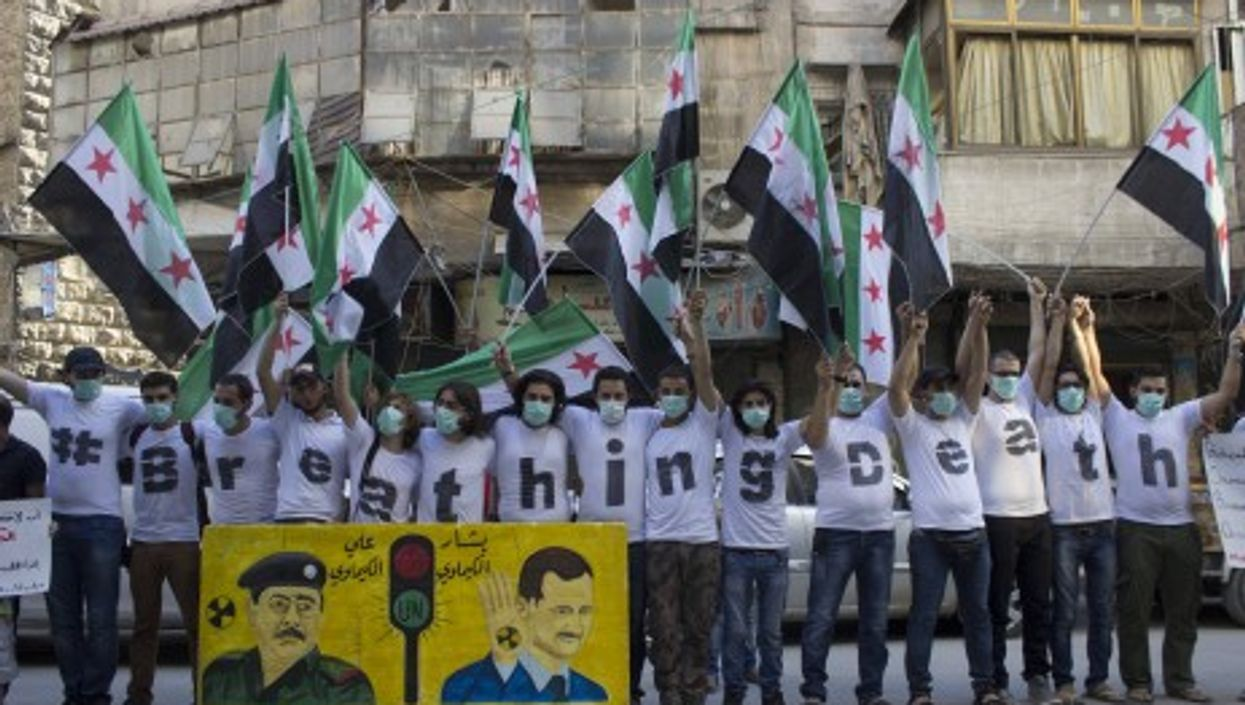 Protest in Aleppo on Aug. 21 to mark the one-year anniversary of the Ghouta massacre.