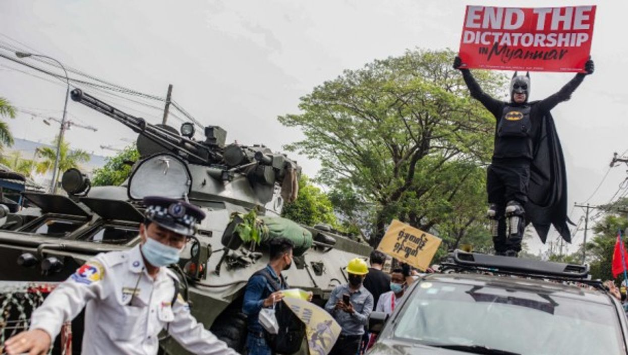 Protesters continue to demonstrate in the streets of Yangon, Myanmar, despite the heightened military presence and the deployment of armored vehicles