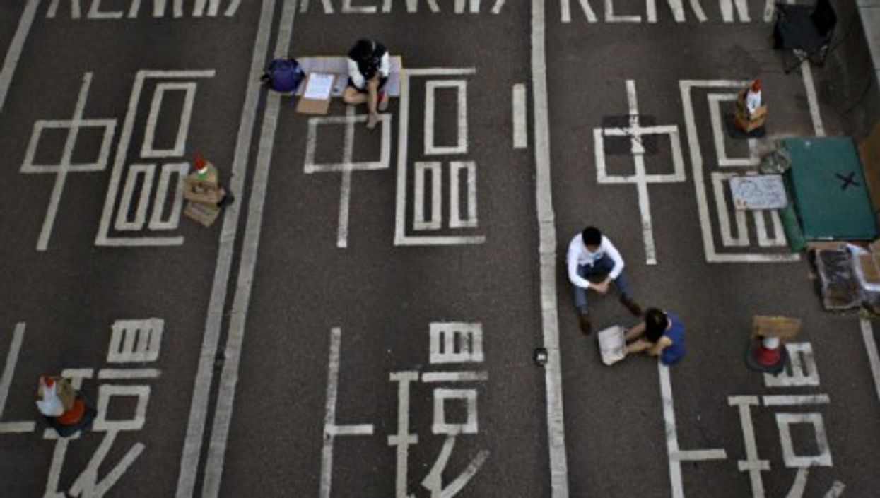 Protesters resting near Hong Kong's Central Government Office on Oct. 7.