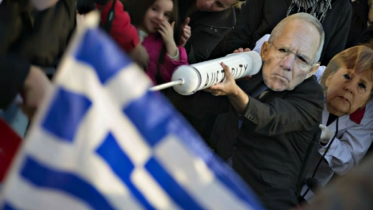 Protesters wearing Schauble and Merkel masks in Athens
