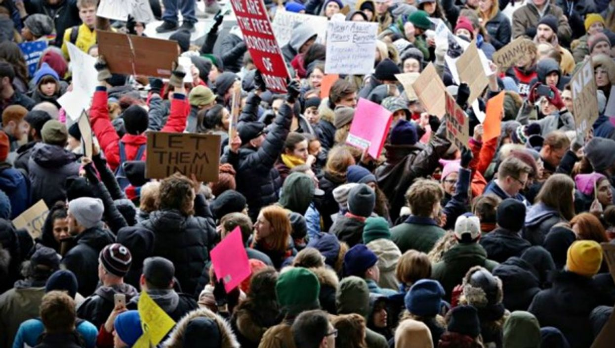 Protestors gathered at New York airports against the Muslim ban