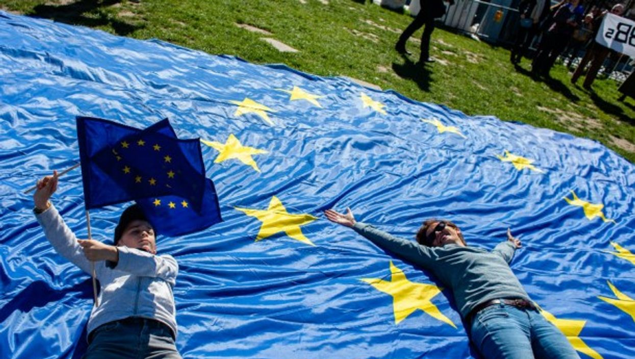 Protestors lay on European Union flag at citizens' march in Brussels, Belgium