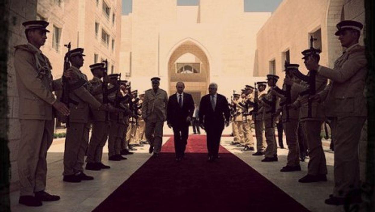 Putin and Palestinian leader Mahmoud Abbas last June