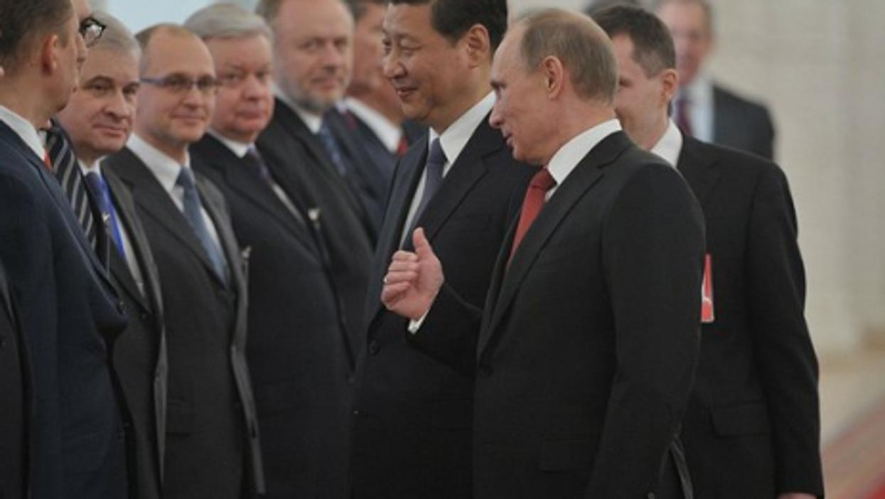 Putin and Xi Jinping at their meeting Friday.