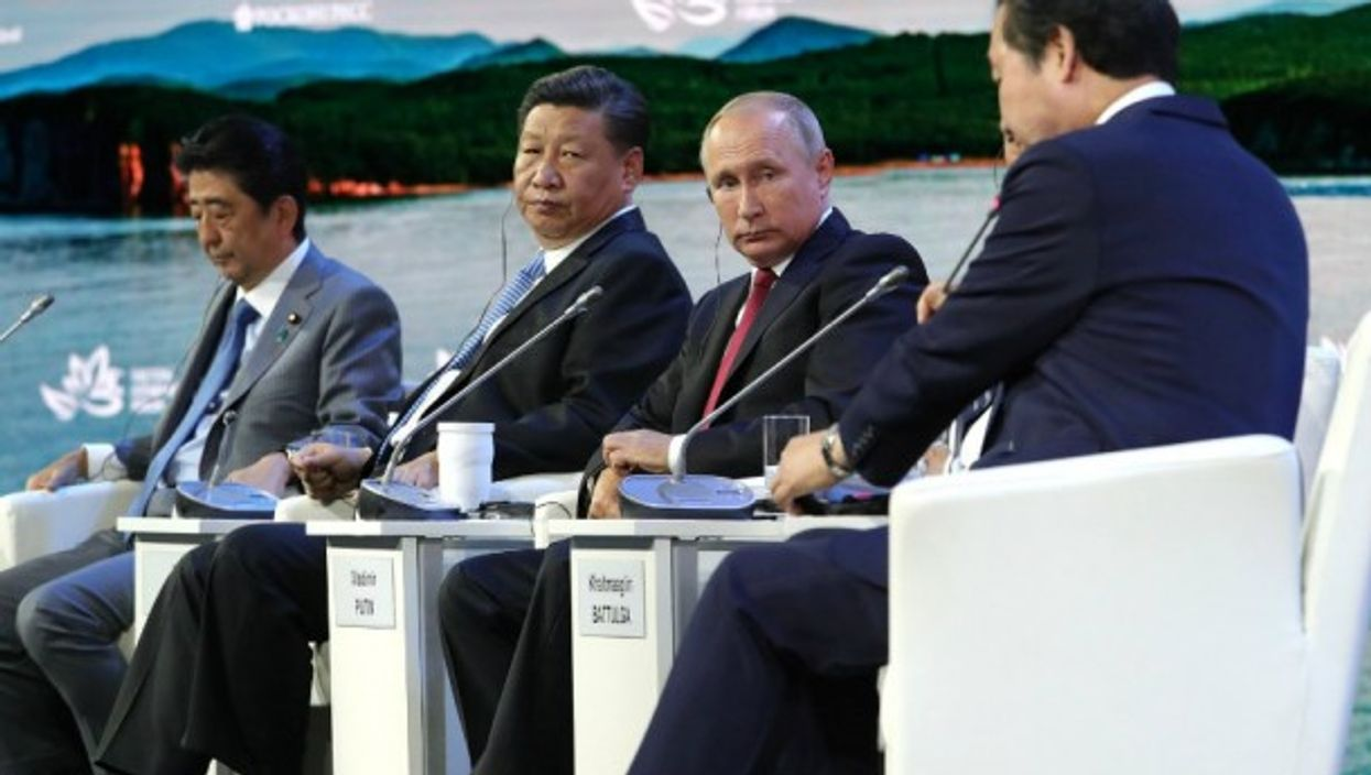 Putin during at the Vladivostok summit in September, between the leaders of Japan, China and South Korea .